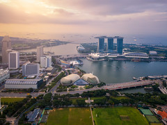 Aerial view of the Singapore landmark financial business district at sunrise scene with skyscraper and over clouds. Singapore downtown (MongkolChuewong) Tags: aerial aerialview architecture asia bay building business city cityscape district dome downtown drone exterior famous ferris flyer garden hotel landmark landscape laser light marina night panorama park river sands sea show singapore singaporecity singaporean sky skyline skyscraper southeastasia sunrise sunset tourism tower travel traveler twilight urban view water waterfront wheel sg