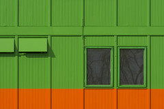 Green and orange site hut (Jan van der Wolf) Tags: map18433v gevel gebouw building facade windows green groen orange oranje lijnen lijnenspel lines interplayoflines playoflines ramen keet bouwkeet sitehut geometric geometrisch geometry geometrie
