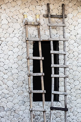 You take the high road, and I'll take the low road (A Different Perspective) Tags: 2 bali bali365 bamboo hole ladder stone wall window wood