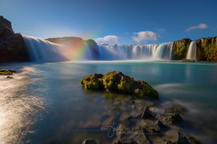 Godafoss Falls, Iceland (Dive Girl DSLR) Tags: outside outdoor landscape vacation tourism travel iceland janelleorthphotography janelleorth godafossfalls rainbow rainbowcolors vibrant vivid longexposure wideangle adventurous beautiful clearwater bluewater cold rockformations rocks scenicview scenic nature natural river flow glacierwater riverbed ice sparklingwater fluid liquid strong powerful sun clearweather destination glow landmark illuminate sunlight magichour motion hiking waterfall cascadingwater pond pool zen