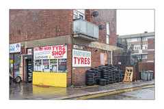 Part Worn Tyres, East London, England. (Joseph O'Malley64) Tags: tyreshop partworntyreshop partworntyres healthsafetyissues healthsafety tyres usedtyres commonsense stupidity shop shopfront businesspremises cornershop eastlondon eastend london england uk britain british greatbritain blocksofflats mainroad thoroughfare highroad housing homes abodes dwellings flats highdensityhousing brickwork bricksmortar cement pointing concrete balcony satellitedishes pallets woodenpallets wheeliebins tarmac granitekerbing doubleyellowlines noparkingatanytime parkingrestrictions signs signage urban urbanlandscape architecture architecturalphotography fujix fujix100t accuracyprecision