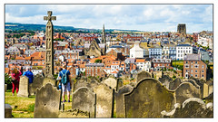 Whitby (Photography And All That) Tags: whitby yorkshire yorks coast coastal town townscape church churchyard graves gravestones vista view people summer daytime outdoors houses buildings churches towns townscapes churchyards cross celtic celticcross caedmon sony sonyalpha7mark3 sonyilce7m3 sonyalpha ilce7m3 landscape landscapes