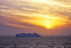 Sunset on ice (Pog's pix) Tags: sunset evening sky clouds sun icebergs antarctica scannedslide ocean water sea glow orange
