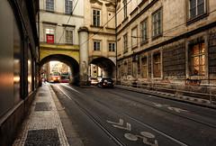 Prague Tram Street (henriksundholm.com) Tags: street tram cars traffic tracks city urban grit pavement sidewalk railing graffiti tunnels prague czechrepublic