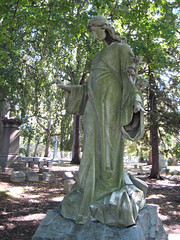 Woman in Green Moss Wearing Lace Holding Flowers 0839 (Brechtbug) Tags: woman green moss wearing lace holding flowers cemetery grave markers head stones graveyard graves yard architecture art sculpture statue women lady marker mourner mourning grief grieving lily flower bronze ivy bronx tomb stone tombstone woodlawn nyc new york city 2007 female figure