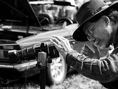 Hassleblad and the hat. (Neil. Moralee) Tags: neilmoralee steamrally2018neilmoralee hassleblad camera photographer man japanese oriental asian format medium film tripod hat beard glasses intent involved engrossed fine art sunshine car outdoor vintage steam rally classic neil moralee olympus omd em5 candid sneaky automotive display black white mono bw bandw blackandwhite portrait cameraman norton fitzwarren somerset uk duracell battery