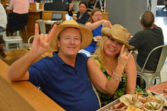 Happy hatters (radargeek) Tags: couple airport dfw dallas fortworth peace rockon hat photobomb eating terminal travel traveling