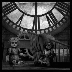 The Doll's Hour (Loegan Magic) Tags: secondlife blackandwhite porcelaindolls clock woodenfloor attic creepy poem scary eyes