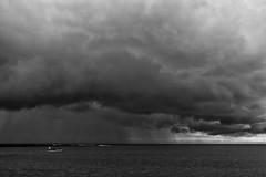 Squall (evans.photo) Tags: weather aberystwyth sea boats rowing rain storm squall fuji monochrome blackandwhite seascape