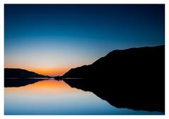 Ullswater Glow (muddybootsuk) Tags: ullswaternorfolkisland daybreak dawn sunrise bluehour water reflections mossdalebay boathouse lakedistrict muddybootsuk nikond810 nikkor landscape calm mountains sky cumbria england northwest northern greatbritain unitedkingdom