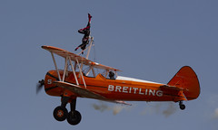 The Flying Circus Wingwalking Team, Shuttleworth Collection Family Air Show, Bedfordshire (IFM Photographic) Tags: img4028a breitlingstearman breitling stearman theflyingcircuswingwalker wingwalker wingwalking nikita aerosuperbatics canon 600d sigma70200mmf28exdgoshsm sigma70200mm sigma 70200mm f28 ex dg os hsm apo tele converter 2x af teleconverter oldwarden bedfordshire beds shuttleworthcollection shuttleworthhouse familyairshow airshow aircraft aeroplane plane airplane boeing