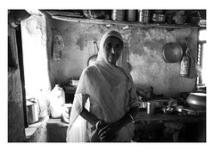 the heart of the home (handheld-films) Tags: india portrait portraiture woman women mother grandmother home interior kitchen indian rural people individual domestic house smile smiling cookingutensils villages monochrome blackandwhite lowlight subcontinent travel