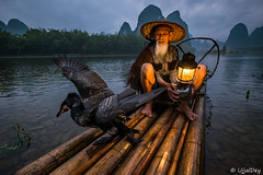Cormorant Fisherman @Yangshuo ~ EXPLORED #31 (03-Aug-2018) (ujjal dey) Tags: ujjal ujjaldey guilin yangshuo china travel traveler fishermen cormorant landscape mountain river reflection dailylife evening fall dusk krast fujifilm xe2s