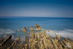 some rocks at bude in cornwall (kapper22) Tags: rocks outdoors beach blue cliff top clear long exposure silky