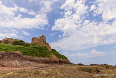 Gorey  (Mont Orgueil) in Jersey and a WW2 bunker. (jack cousin) Tags: 13thcentury channelislands gorey goreycastle jersey montorgueilcastle uk ww2 battlements beach bluesky bricks bunker bush camouflage castle cliff cloud coast defence flag fort fortification fortress gunposition medieval parapet pebbles rocks sand seashore shrub sky stonework tourism tower tree wall nikond610 on1photos