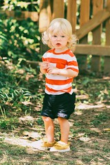 lost boy (eva michie) Tags: boy portrait forest sun light cool interesting awesome lost lonely sad scared frightened afraid photography camera digital different green stripes baby red white yellow child blue eyes august summer