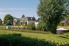 Ten Boer, am Damsterdiep (antje whv) Tags: windmühlen windmühleninholland molen mills holland nederland netherlands damsterdiep häuser houses boote boats tenboer