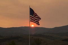 Red Sunset and Giant Flag (aaronrhawkins) Tags: sunset flag america unitedstates mountain red fire firey smoke wildfire west western pole bearlake gardencity utah aaronhawkins