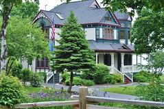 Beautiful Victorian on the shore of Lake Michigan (stevelamb007) Tags: wisconsin doorcounty baileysharbor victgorian house architecture landscaping colorful stevelamb nikon d90 nikkor 50mmf18 victorian