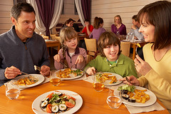 Family Eating Lunch Together In Restaurant (JB W Singelton) Tags: 4people 40s 6yearold 9yearold adult boy busy casualclothing caucasian children dad daughter eating enjoying family father female food forties france frenchalps girl happy healthy horizontal indoors lunch male man meal midage middleaged mom mother mum parents people restaurant samoens sitting smiling son table together woman