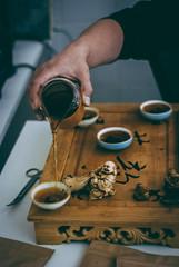 tea master at work (YellowTipTruck) Tags: teamasteratwork teaparty bunfight greentea tea crockery dishes pouredtea teagods teatable