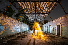 Feel the burn! (Waving lights in the dark) Tags: longexposure sonyimages wavinglightsinthedark backlit backlight nightphotography nocturnal darkness lightjunkies shutternights addictedtonights abandoned dark night spin silhouette concrete texture shadow fire steelwool burn burning derelict colliery