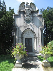IMG_7501 (Brechtbug) Tags: roof sitting angel clutching sword above mausoleum entrance granite greenwood cemetery statue wings graveyard tomb horn tombstone crypt mausoleums angels swords seated green wood brooklyn new york city 2018 nyc located corner border ave sassafras 08122018