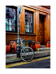 Bike (Dave Fieldhouse Photography) Tags: london bricklane shoreditch street streetphotography observation object bicycle bike pushbike building doubleyellowlines road photo24london photography colour morning lampost fuji fujifilm fujinon35mmf2 fujixpro2 wwwdavefieldhousephotographycom red doorway experimental