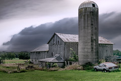 Traveling Days Are Over (henryhintermeister) Tags: barns minnesota wibarns oldbarns clouds farming countryliving country sunsets storms sunrises pastures nostalgia skies outdoors seasons field hay silos dairybarns building architecture outdoor winter serene grass landscape plant cloudsstormssunsetssunrises omrowi yextwisconsin
