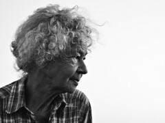 Evening Portrait (d_t_vos) Tags: woman portrait evening contrast face sideview side curlyhair wrinkles oldwoman pilgrim pilgrimage smile blouse bw blackandwhite schwarzweiss noireetblanc outside streetphotography streetportrait candid zwartehaan nachtaanhetwad lf2018 santiagoaanhetwad wadcamino finisterre finisterreaanhetwad people dickvos dtvos