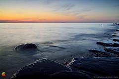 When the Sun Goes to Sleep - Lake Erie Sunset (DTE_1305) (masinka) Tags: great lake erie etbtsy dusk quiet peaceful lakeshore shoreline shore buffalo ny rock rocky nature landscape photography color outdoors longexposure slowshutter westernnewyork westernny newyork