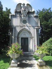 IMG_7500 (Brechtbug) Tags: roof sitting angel clutching sword above mausoleum entrance granite greenwood cemetery statue wings graveyard tomb horn tombstone crypt mausoleums angels swords seated green wood brooklyn new york city 2018 nyc located corner border ave sassafras 08122018
