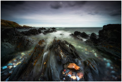 Strange but Familiar (Augmented Reality Images (Getty Contributor)) Tags: niisfilters aberdeenshire benro canon clouds coastline horizon landscape longexposure rocks sandend scotland seascape water waves
