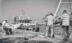 The Old Man (Paul B0udreau) Tags: layer niagara nikon d5100 italian italy nikond5100 paulboudreauphotography vivaitalia photomatix ontario canada ostia fiumicino port water nikkor50mm18 boat people bw nets ropes photoshop