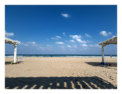 Friday 09:01 (Raul Kraier) Tags: mediterranean bathers people clouds foam waves friday morning leisure