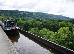 Walking over Pontcysysllte aqueduct, the canal in the sky. (trishmcgrattan) Tags: aquaduct riverdee green walk pontcysyllteaquaduct trees countryside boat northwales llangollen canal