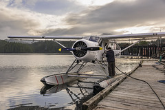 Gassing up for an early morning flight (tmeallen) Tags: seaplane sealcove seaplanebase gassingup fueling man fuelline clouds water reflections princerupert britishcolumbia mountains transportation wildernessaccess singleengine