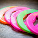 Colorful frisbees on wood