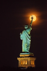 Full Moon rising... (Nina Wolfe Photography) Tags: soljerseycity nyc newyorkcity statueofliberty clear fair waterfront libertystatepark night nikon sigma architecture america torch travel urban fullmoon moonphotography reflections partlycloudy