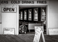 cold drinks (Point Pleasant Beach) (Steve Stanger) Tags: beach beachscape beachseries cloudybeachmorning boardwalk food cold drinks jenkinsons pointpleasantbeach blackandwhite bw olympus 25mm lumixg25mmf17 prime primelens seashore summer jersey shore nj