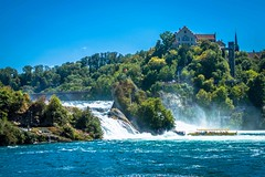 The Rhine Falls (German: Rheinfall) is a waterfall located in Switzerland and the most powerful waterfall in Europe. The falls are located on the High Rhine on the border between the cantons of Schaffhausen and Zürich .