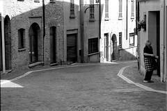 """ pitturare..."" (Davide Zappettini) Tags: woman old medioeval filmphotography bw bianconero blackandwhite street paint"