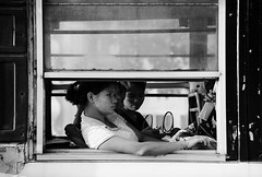 (cherco) Tags: woman window city composition composicion canon ciudad chica blackandwhite blancoynegro asia myanmar urban bus transport bnw town shadow light sombra travel wait face paint contrast contraste portrait calle canoneos5diii reflexions crystal frame