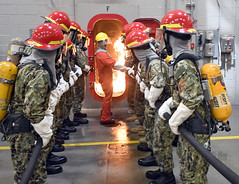 Naval Reserve Officers Training Corps candidates fight a fire in a simulated. (Official U.S. Navy Imagery) Tags: standardizedentrylevelmilitarizationandpreparenewnrotcmidshipmenwithacommontraining greatlakes ill unitedstates
