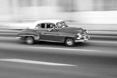 Taking Panning Photographs (Geraint Rowland Photography) Tags: panning panned panningphotos howtopaninphotography cars classiccars cubancars carsofcuba cubantourism havana lahabana city urban transport drive driving speed taxis blackandwhite motion traveller travelingincub latinamerica carsandcuba communism geraintrowlandphotography wwwgeraintrowlandcouk photographytips howtotakephotos photolessons photoblogs
