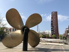 A retired modern marine propeller greets Hamburg-HafenCity. (arwed.kubisch1) Tags: hamburg hanseatic hansestadt city stadt hafencity marine propeller schiffschraube cloudy sunny sky wolkig sonnig himmel