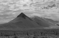 Cold Iceland Mountains (adamrferry) Tags: cold winter iceland landscape mountain mountainrange blackwhite blackandwhite peak icelandic nordic season roadtrip frozen snow snowy sky cloudy moody clouds freeze rocky