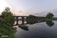 Wooden bridge on the river Korana (malioli) Tags: bridge river wooden tree sunrise down boat sky clouds water serenity canon croatia hrvatska europe