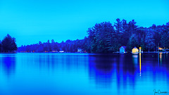 First Lake at Blue Hour (iecharleton) Tags: landscape seascape lake shore trees lighthouse reflection buildings longexposure bluehour upstatenewyork newyork tourism travel outdoors nature calm inlet evening
