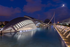 Calatrava by night (Maerten Prins) Tags: spain spanje valencia calatrava santiagocalatrava architect architecture modern cityofartsandsciences concrete curve curves hemisfèric imax cinema eye shape night dark water reflection bridge pontdelassutdelor basin mozaic symmetry glass windows lights moon clouds longexposure sky building